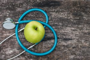 Picture of an apple and a stethoscope